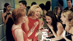 The ladies from Sex and the City have a giggle over the nipple enhancers Samantha has in her hands.